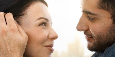 A woman smelling a man