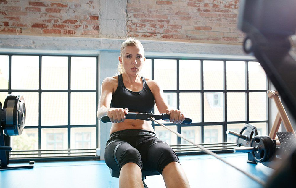 6 Ways to Burn More Calories on a Rowing Machine | Women's Health