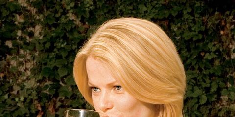 Alcohol effect and women: Blonde woman drinking alcohol