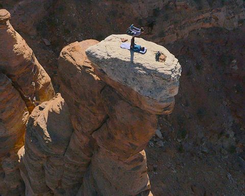 People Doing Acrobatic Yoga on the Edge of 600-Foot Cliffs Will Give You a Heart Attack