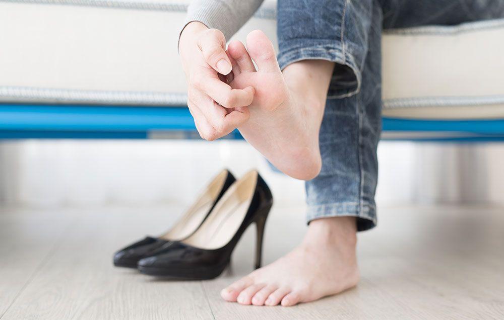 Foot up her ass