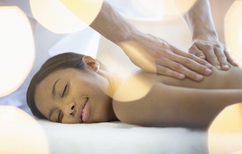 Massage Therapist Rubs A Guys Chest