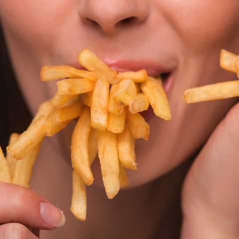 woman chewing french fries