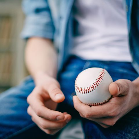 Baseball equipment, Finger, Ball, Sports equipment, Ball game, College baseball, Bat-and-ball games, Team sport, Ball, Denim,