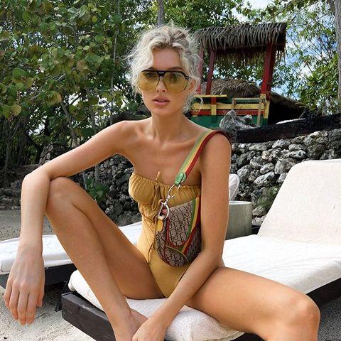 Clothing, Bikini, Monokini, Sitting, Swimwear, Fashion model, Leg, Beauty, Fashion, Model,