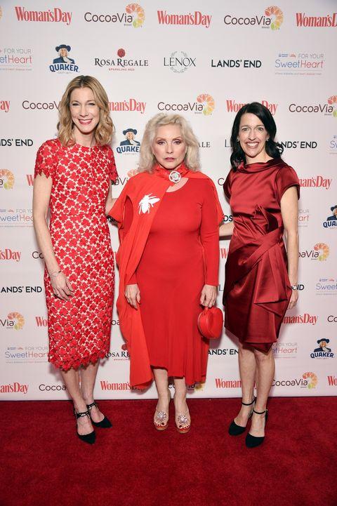 Red, Dress, Clothing, Cocktail dress, Fashion, Carpet, Event, Red carpet, Flooring, Premiere,