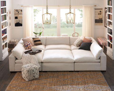 Furniture, Living room, Room, Couch, Interior design, Floor, Property, Wood flooring, Product, Laminate flooring,