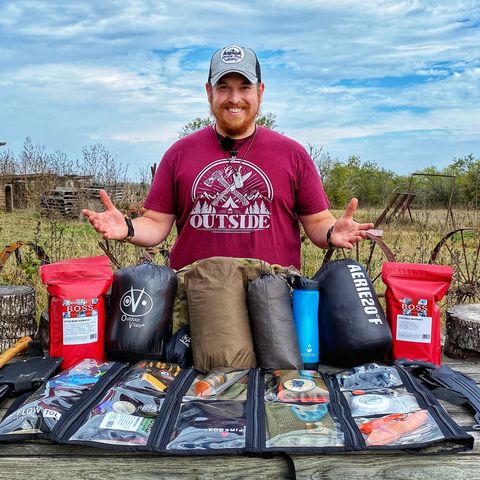 survivalist chris thorn with his survival equipment