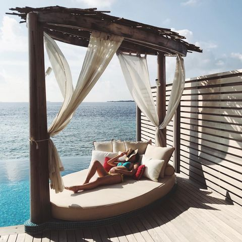 Gazebo, Outdoor furniture, Furniture, Canopy bed, Leisure, Vacation, Swing, Shade, Pergola, Architecture,