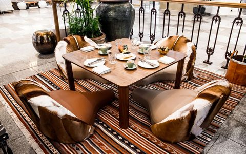 Table, Dining room, Furniture, Room, Coffee table, Tablecloth, Brown, Interior design, Textile, Kitchen & dining room table,