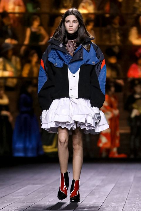 Fashion, Fashion model, Runway, Fashion show, Clothing, Blue, Street fashion, Electric blue, Outerwear, Shoulder,