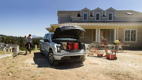 2022 ford f 150 lightning xlt pre production model with available features shown available starting spring 2022 cargo and load capacity limited by weight and weight distribution