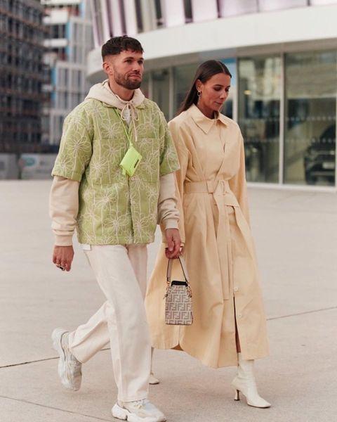 Clothing, Street fashion, Fashion, Trench coat, Outerwear, Yellow, Fashion design, Coat, Beige, Footwear,