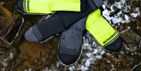Glove, Personal protective equipment, Litter, Fashion accessory, Shoe, Puddle, Splint boots,