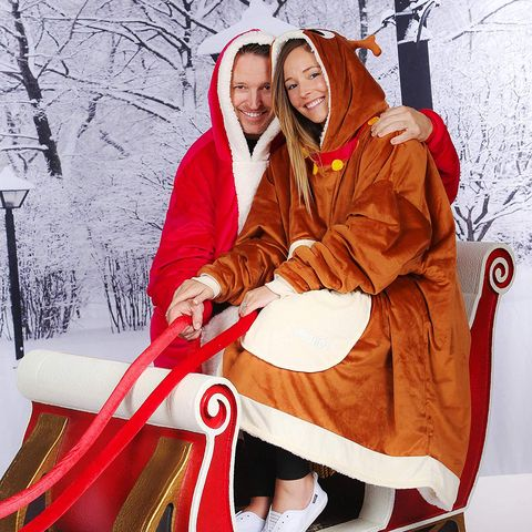 hetrosexual couple wearing outlandish christmas outfits