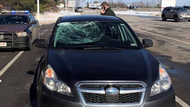 ice chunk smashes the windshield of a subaru legacy in new hampshire