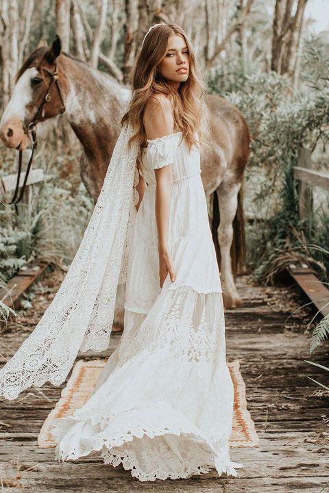 Clothing, White, Dress, Wedding dress, Gown, Long hair, Beauty, Photo shoot, Outerwear, Fashion,