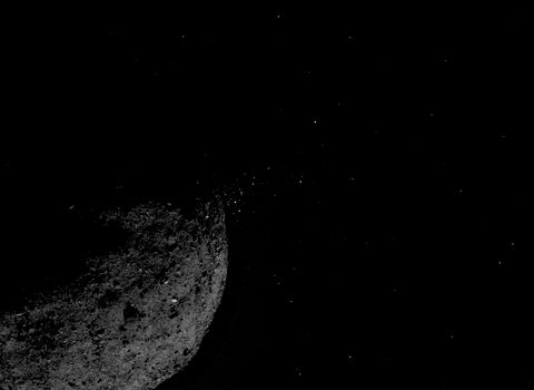 The asteroid Bennu ejects material into space.
