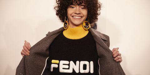 Hair, Black, Yellow, Hairstyle, T-shirt, Jheri curl, Smile, Outerwear, Fun, Photography,
