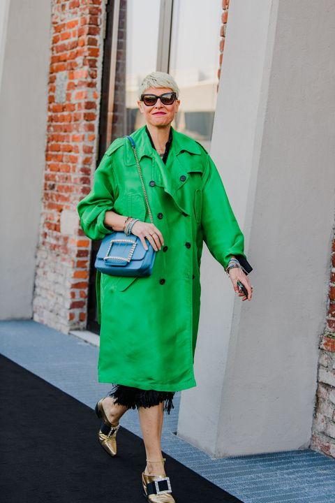 Green, Clothing, Street fashion, Fashion, Coat, Trench coat, Outerwear, Overcoat, Footwear, Eyewear,