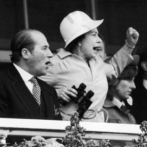 The Queen and her racing manager Lord Porchester watch the finish of the 1978 Epsom Derby .