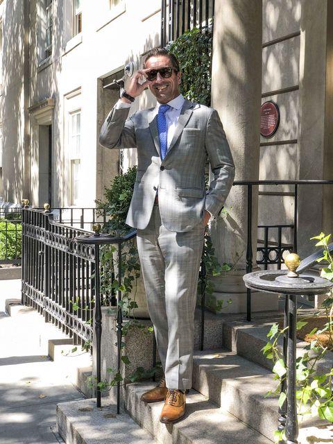 Suit, Statue, Outerwear, Uniform, Pantsuit, Street fashion, Monument, Sculpture, Trousers, Art,