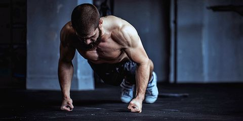 Push-ups on fists in gym