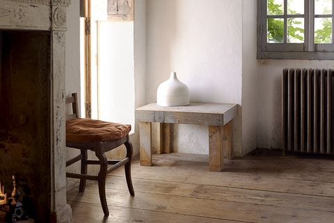 Creative French farmhouse belonging to designer of antique textiles, murals and mirrors, Mathilde Labrouche