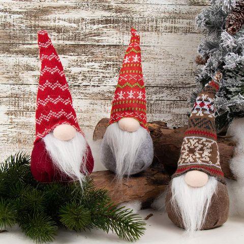 Santa claus, Christmas, Christmas tree, Garden gnome, Tree, Christmas decoration, Lawn ornament, Christmas ornament, Interior design, Fictional character,