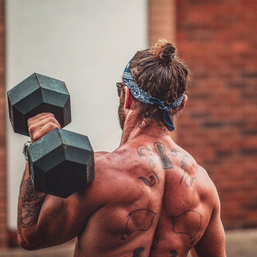 This Home Workout Will Build Boulder Shoulders and a Barn Door Back in Lockdown