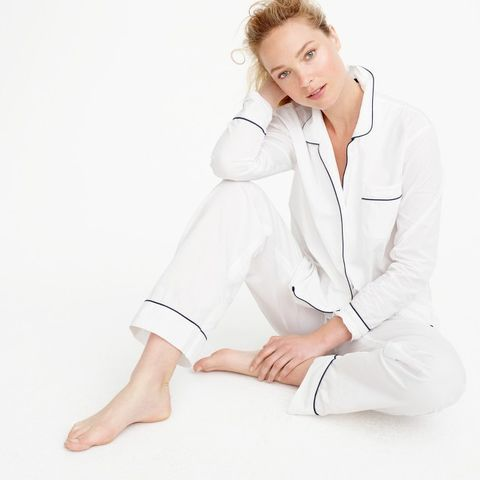 White, Clothing, Sitting, Outerwear, Standing, Neck, Sleeve, Uniform, Leg, Footwear,