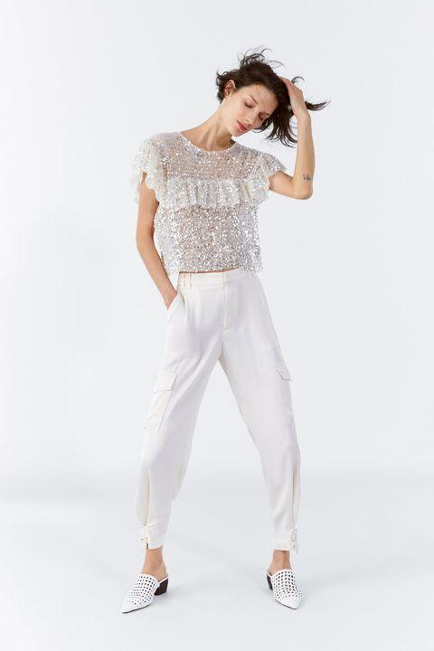 Clothing, White, Shoulder, Waist, Fashion model, Neck, Fashion, Sleeve, Trousers, Leg,