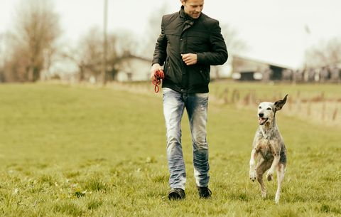 man walking with dog to ease anxiety