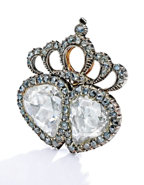 Jewellery, Fashion accessory, Diamond, Body jewelry, Gemstone, Ring, Engagement ring, Silver, Crown, Platinum,