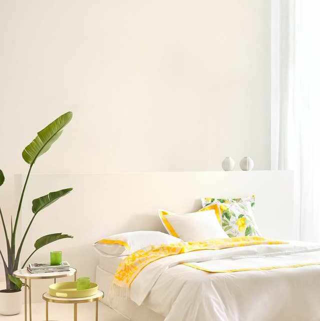 Furniture, Yellow, Room, Bed, Bed sheet, Bedroom, Product, Interior design, Bedding, Wall,