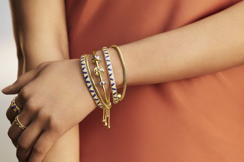 Bracelet, Jewellery, Fashion accessory, Bangle, Wrist, Arm, Yellow, Hand, Finger, Joint,
