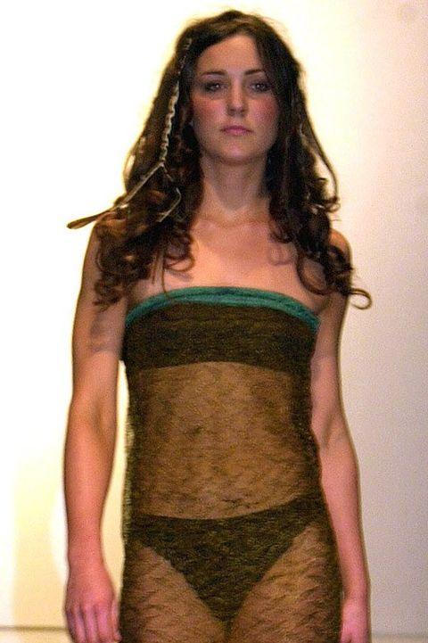 Clothing, Fashion model, Fashion, Dress, Shoulder, Cocktail dress, Fashion show, Runway, Joint, Brown,