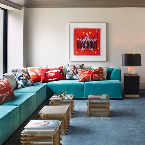 Living room, Furniture, Room, Couch, Interior design, Red, Blue, Turquoise, Property, Table,