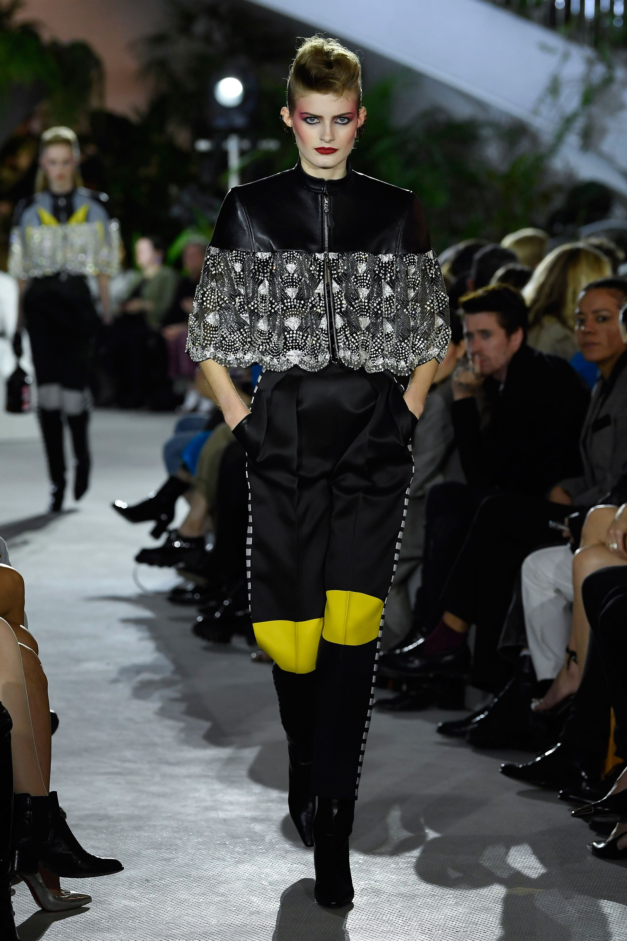 There were also several nods to comic book superheroes with a black and yellow color palette and sturdy combat boots.