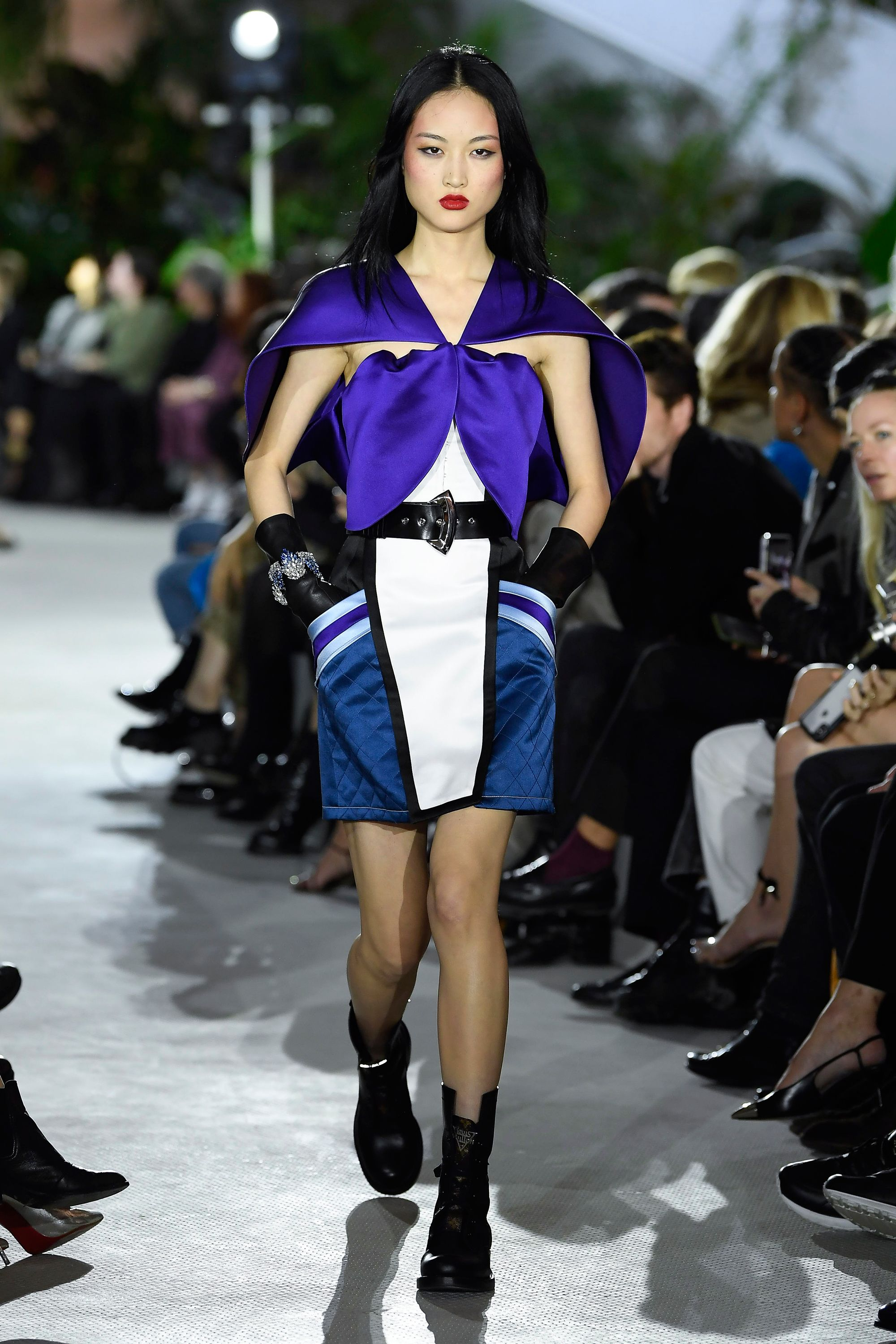 Cape-like tops and severe shoulder pads also brought to mind classic futurism, with a nod to Star Trek 's signature costuming.