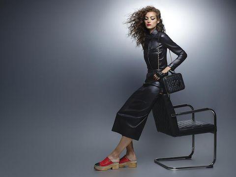 Fashion model, Clothing, Standing, Photo shoot, Sitting, Fashion, Leg, Shoulder, Footwear, Photography,