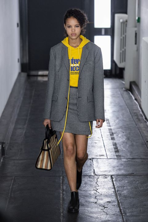 Fashion model, Fashion, Clothing, Fashion show, Street fashion, Runway, Outerwear, Yellow, Snapshot, Footwear,
