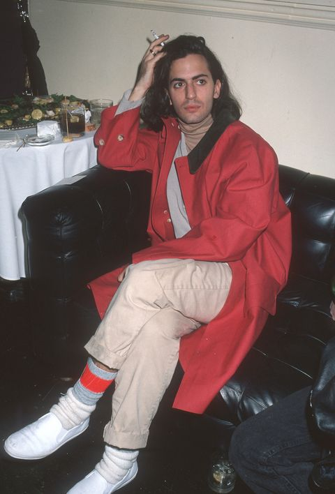 Red, Outerwear, Jacket, Leg, Footwear, Sitting, Textile, Cool, Jeans, Shoe,
