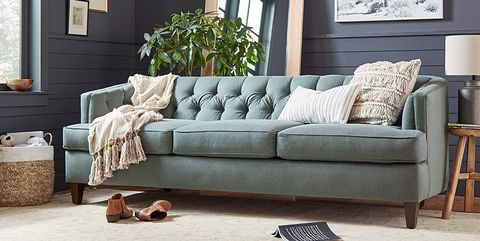 Living room, Furniture, Couch, Room, Interior design, Sofa bed, Brown, studio couch, Wall, Coffee table,