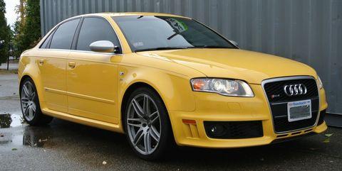 Land vehicle, Vehicle, Car, Audi, Motor vehicle, White, Alloy wheel, Automotive design, Yellow, Audi rs 4,