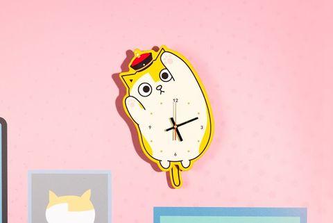 黃色的貓咪時鐘