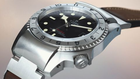 Product, Analog watch, Watch, Glass, Photograph, Watch accessory, Fashion accessory, Font, Black, Metal,