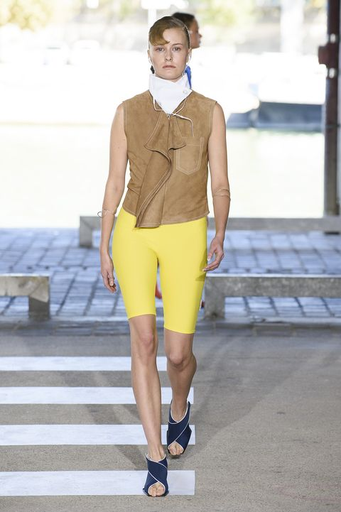 Clothing, Fashion, Fashion model, Yellow, Shorts, Fashion show, Cycling shorts, Runway, Bermuda shorts, Footwear,