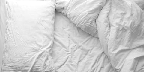 White, Bedding, Bed sheet, Textile, Linens, Duvet cover, Duvet, Room, Pillow, Furniture,
