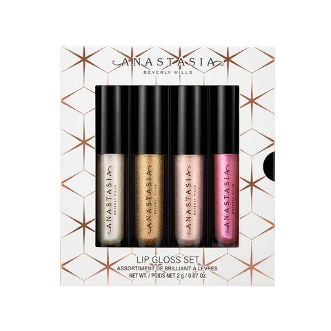 Pink, Cosmetics, Lip gloss, Eye, Eye shadow, Material property, Beige, Eye liner, Lip care,